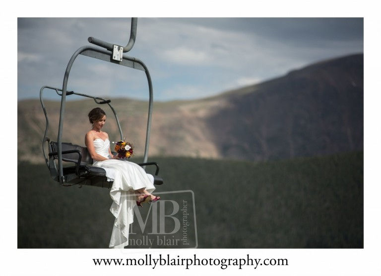 Bride arriving on a chair lift Winter Park